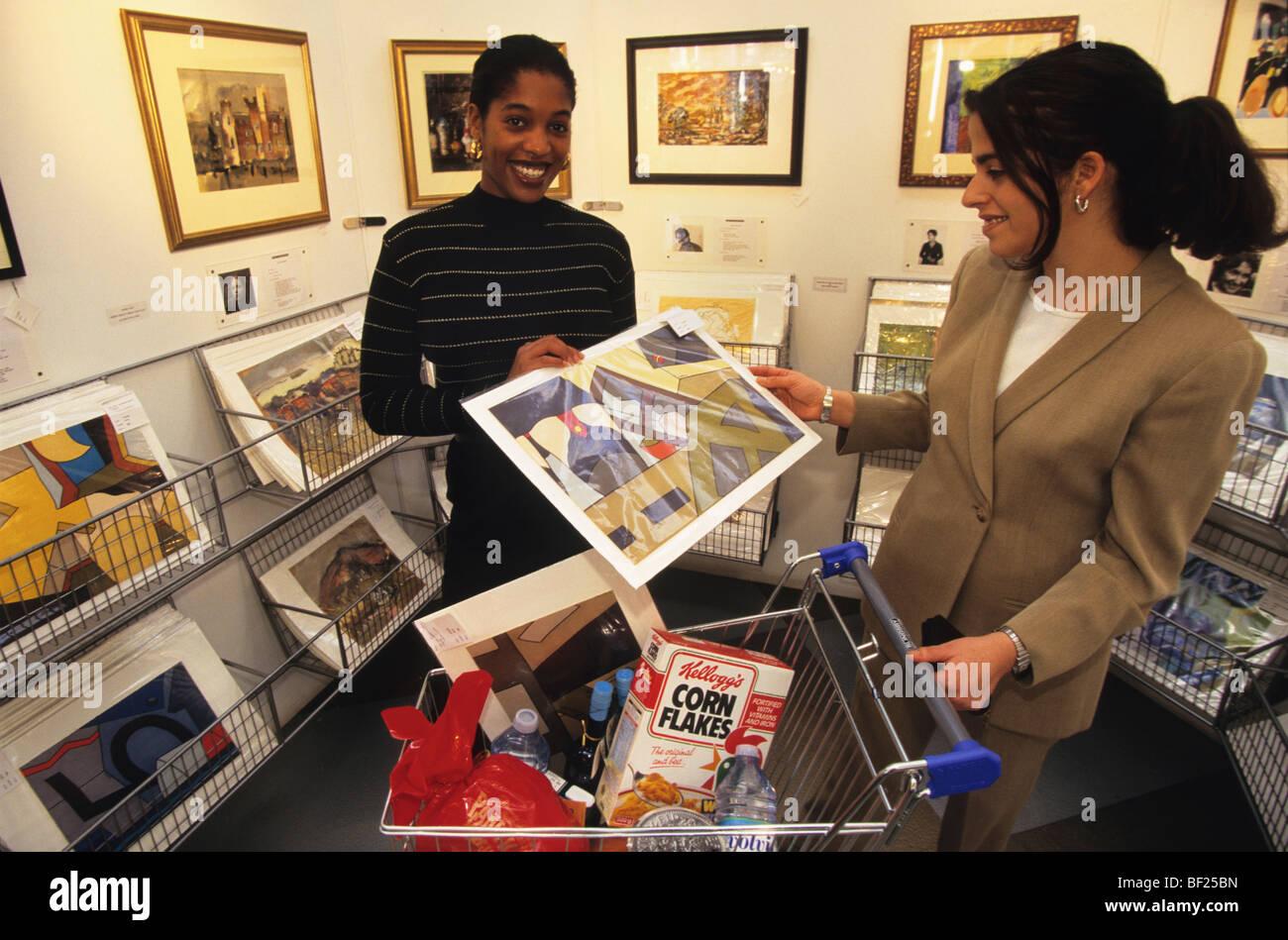 Buying art off the peg at Harvey Nicholls, London - Stock Image