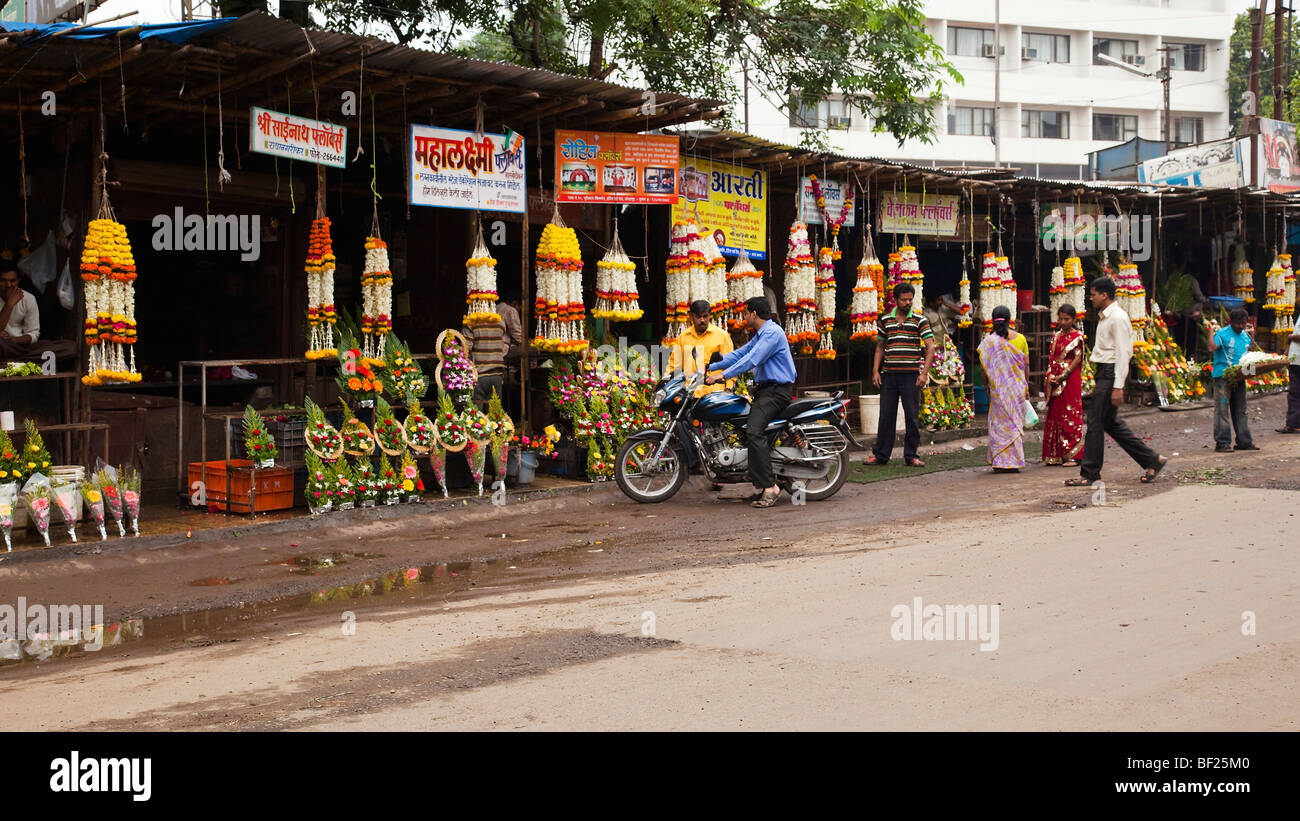 Garlands of flowers being sold in preparation for the Eid ul Fitr festival. Kolhapur Maharashtra India - Stock Image
