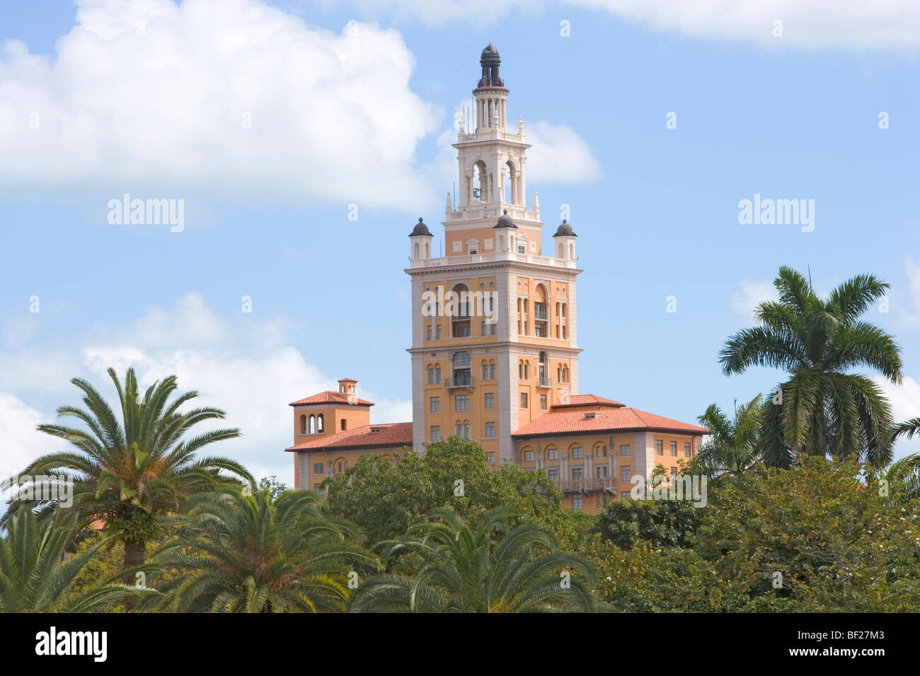 The tower of the Biltmore Hotel above tree tops, Miami, Florida, USA - Stock Image