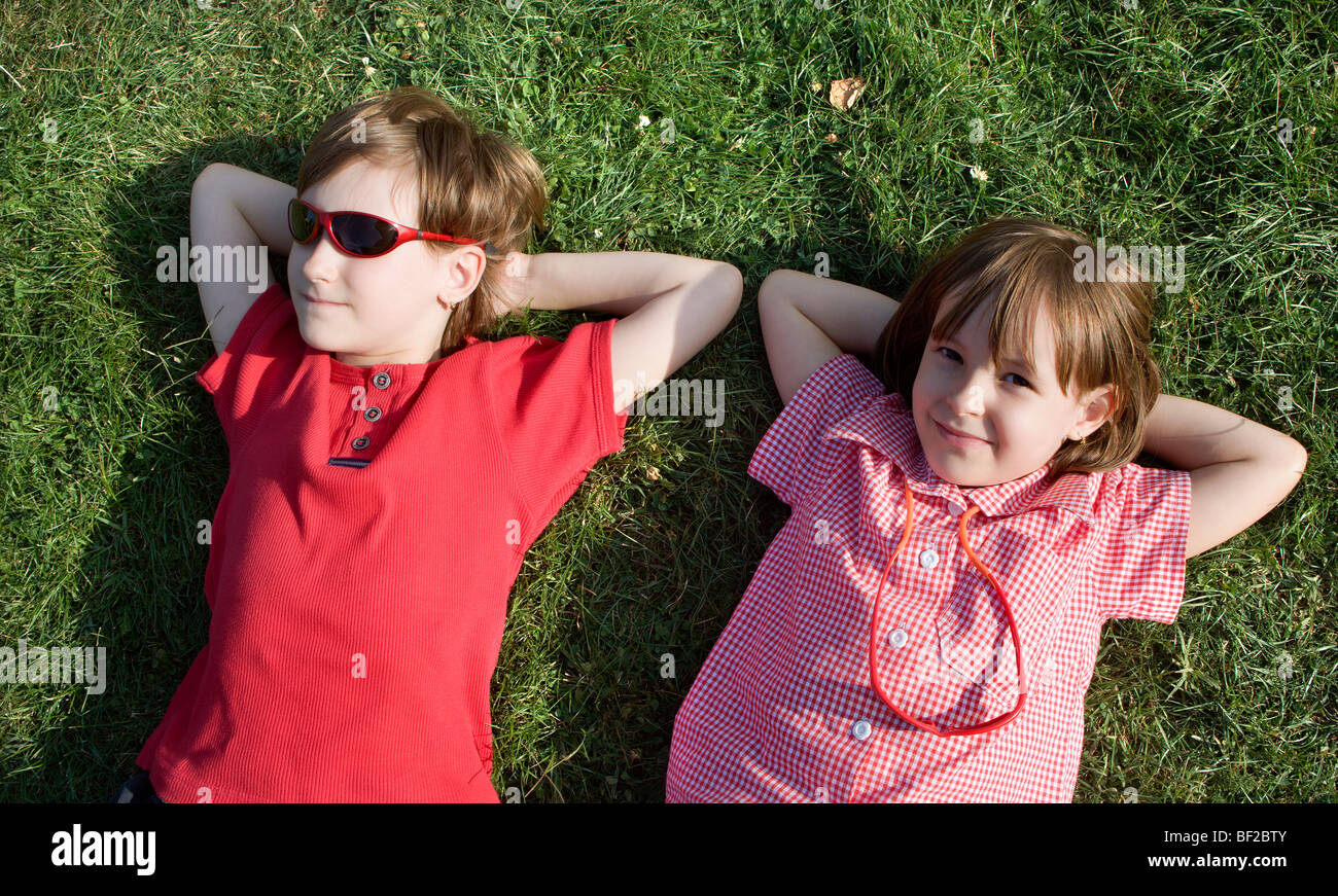 sisters by rest in the park - Stock Image