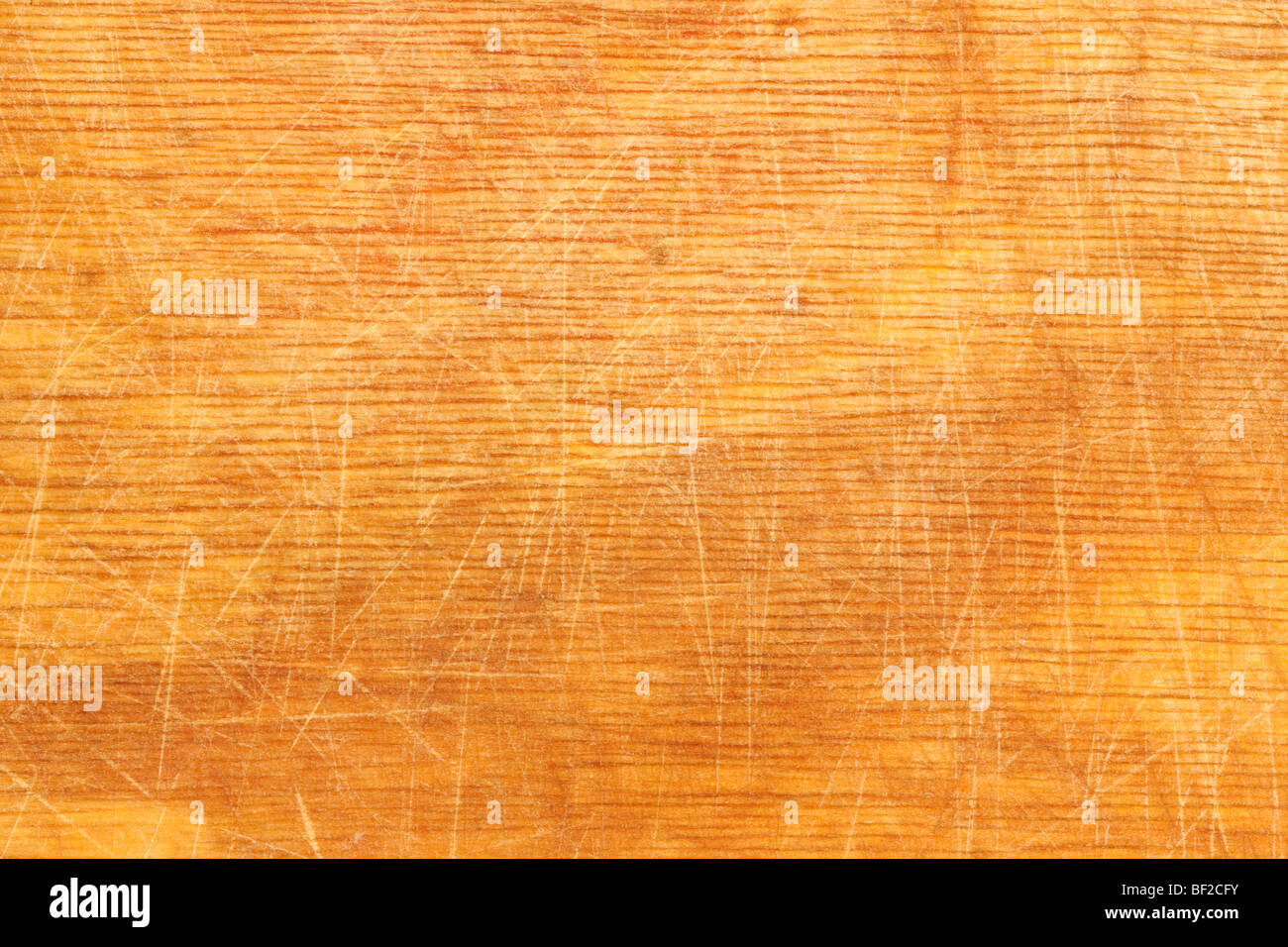 Well-used wood chopping board providing good texture for backgrounds - Stock Image
