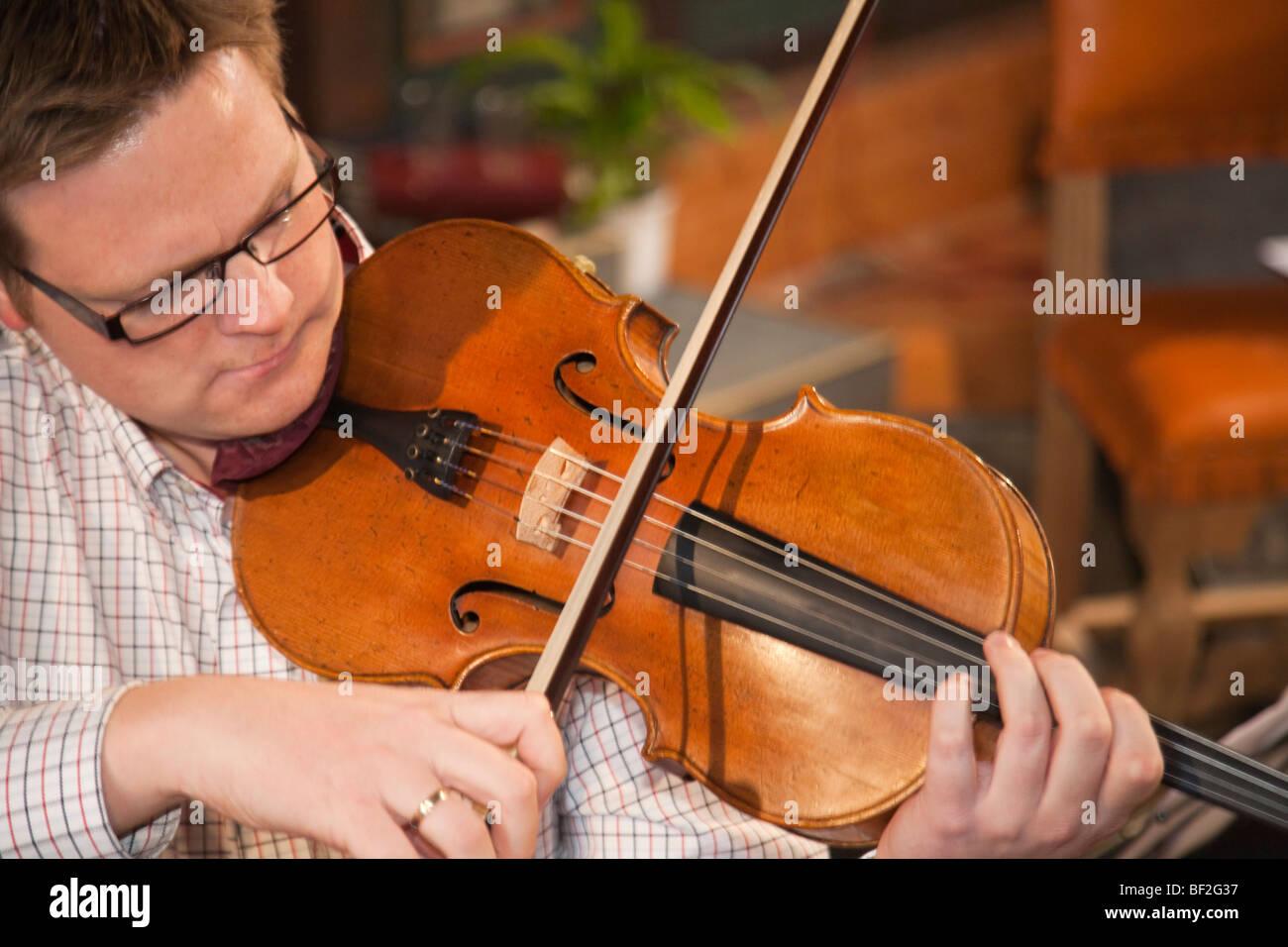 Norway Selbu church Trondheimsolistene viola player - Stock Image