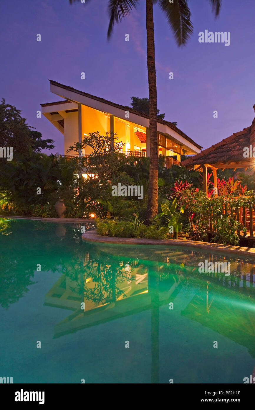 A Luxury Tropical Modern Villa With Swimming Pool Surrounded By Tropical  Gardens   Stock Image
