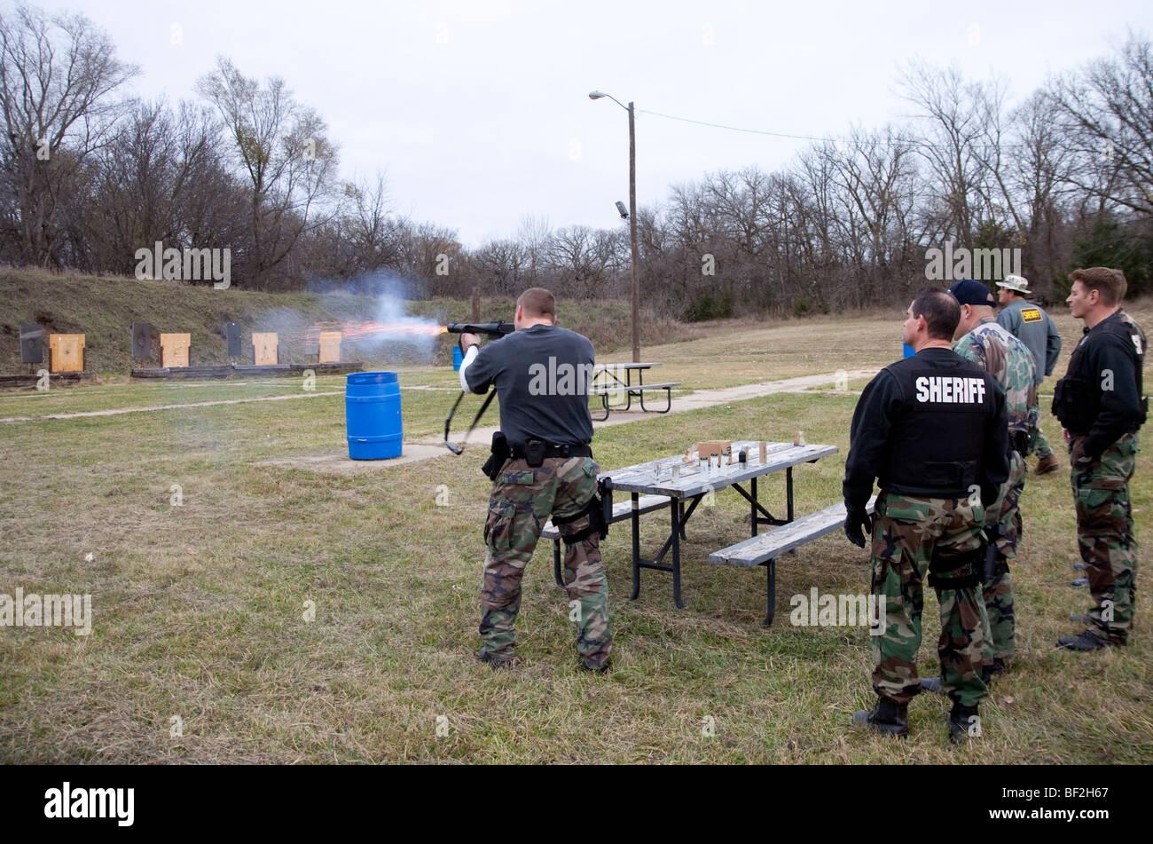 Deputy sheriffs using gas munitions on shooting range. - Stock Image