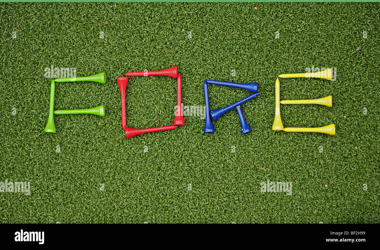 colorful golf tees spelling out the word fore on a putting green