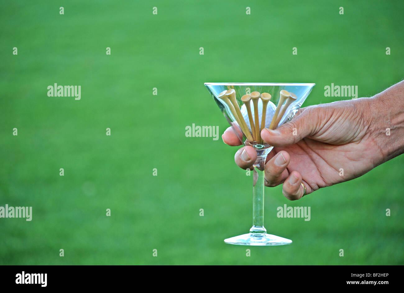Hand Holding Martini Glass Stock Photos & Hand Holding Martini Glass ...