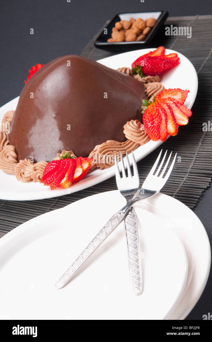 Chocolate dessert served with strawberries - Stock Image