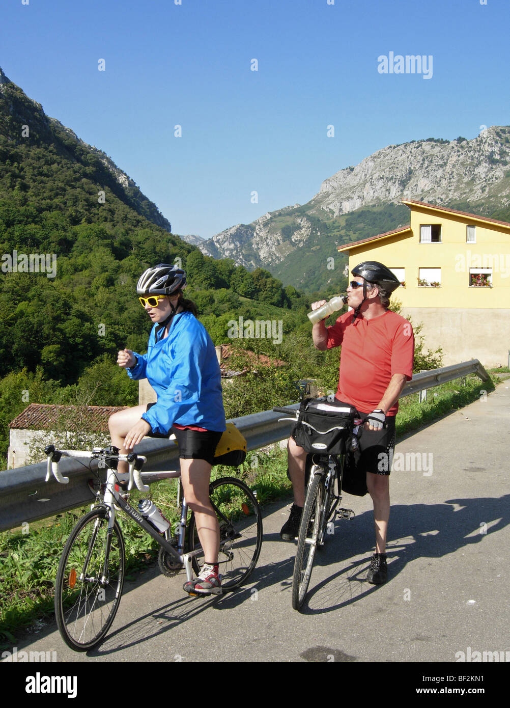 Cyclists Taking A Break On A Bicycle Road Trip Through The Picos De