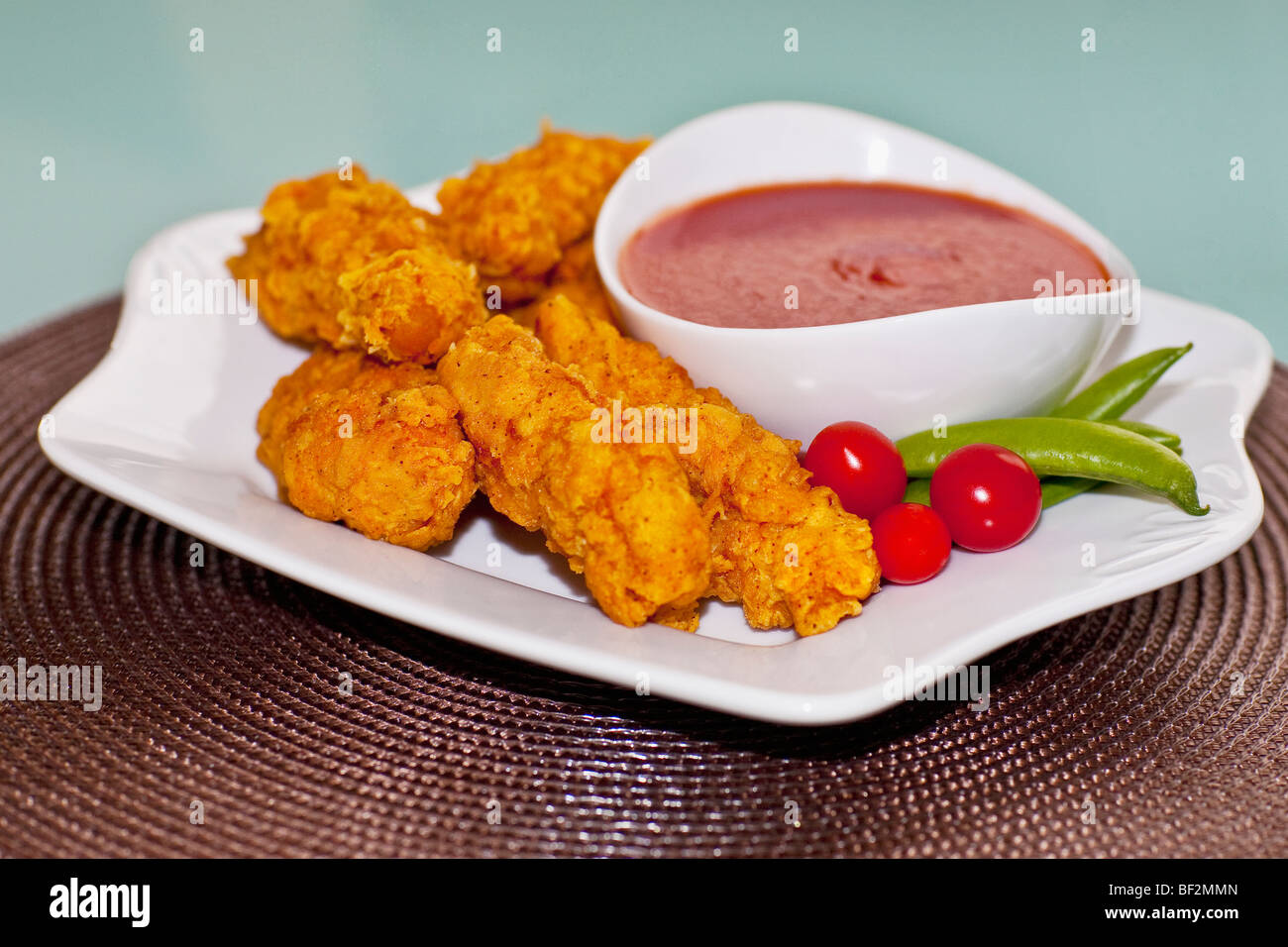 Batter fried chicken with ketchup - Stock Image