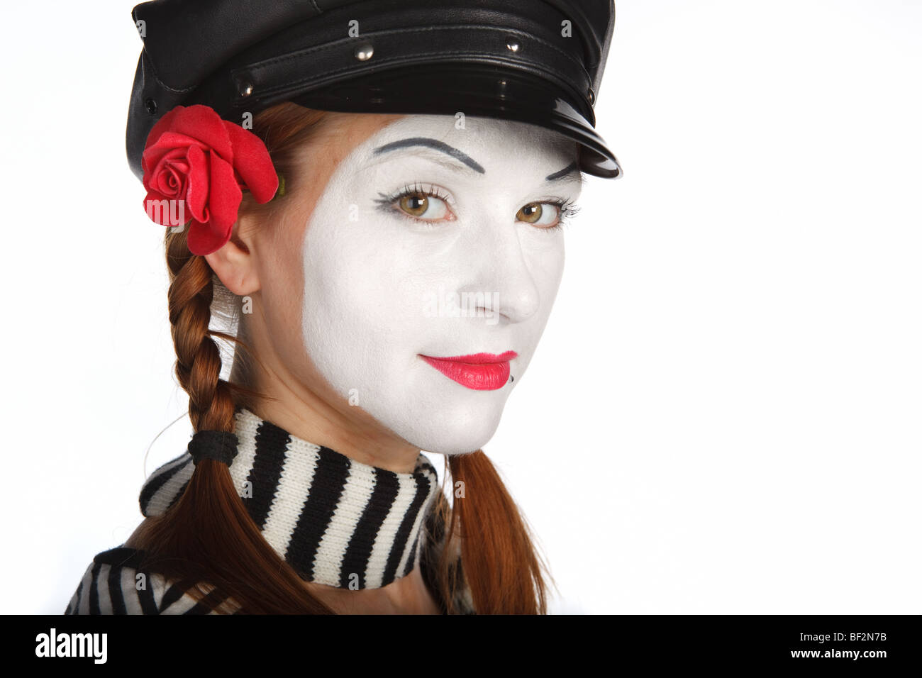 Portrait of a young lady dressed up as a mime, isolated over white background - Stock Image