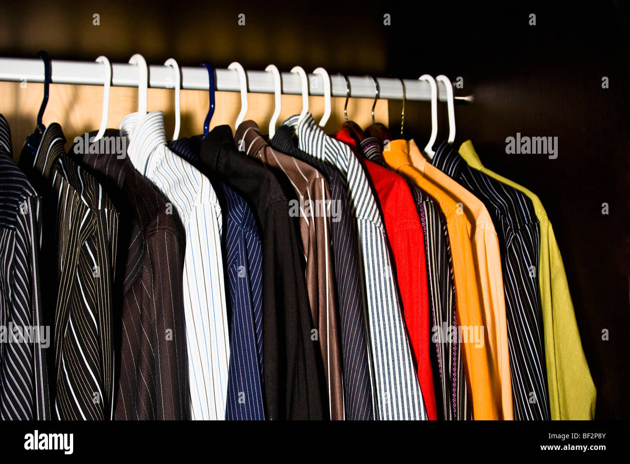 Clothes hanging in a row - Stock Image