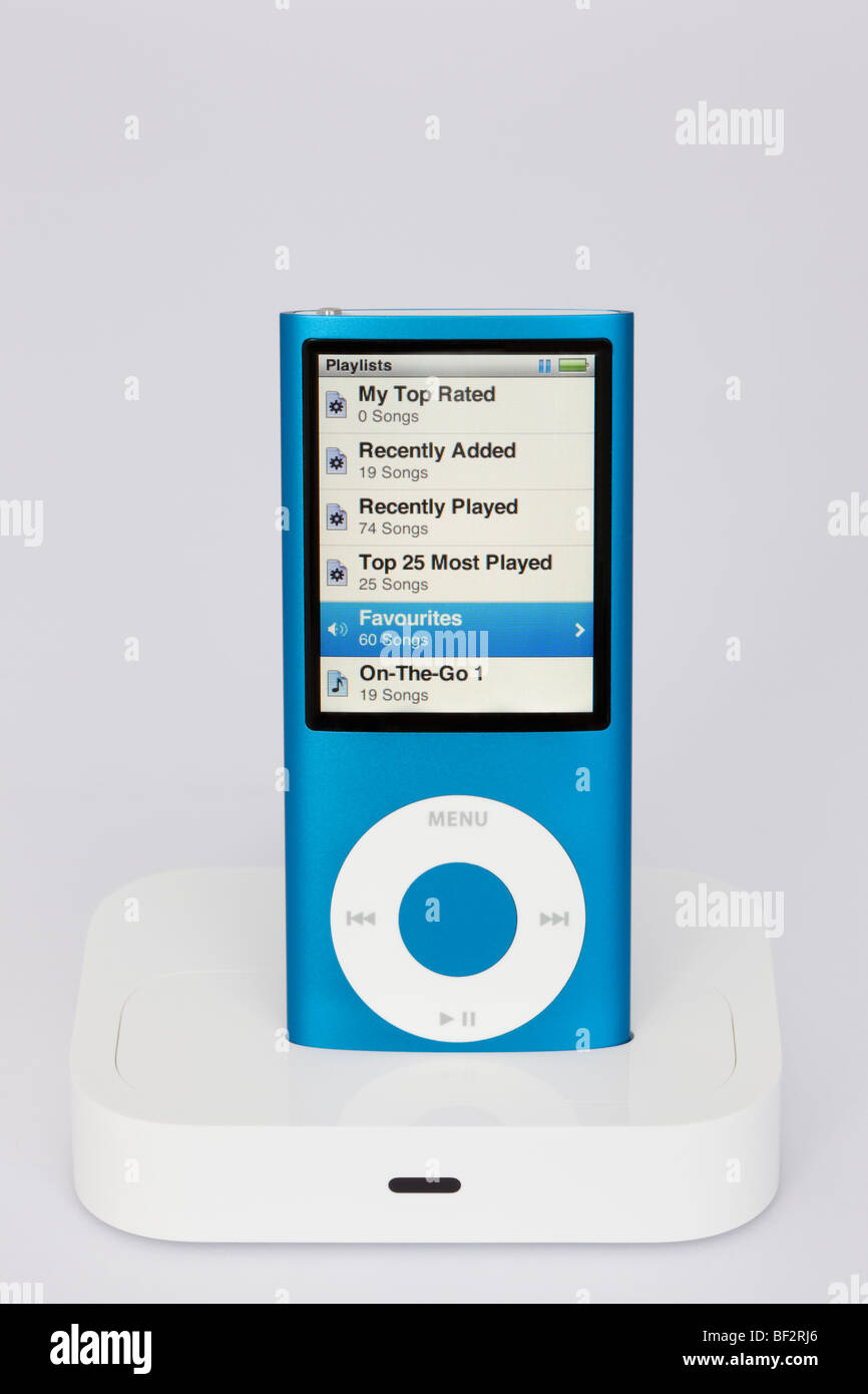 Blue Apple iPod Nano 4G in a dock with playlist view on screen. - Stock Image