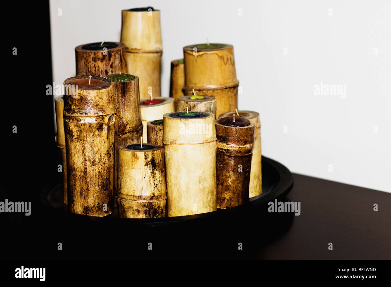 Bamboo shaped candles in a tray - Stock Image