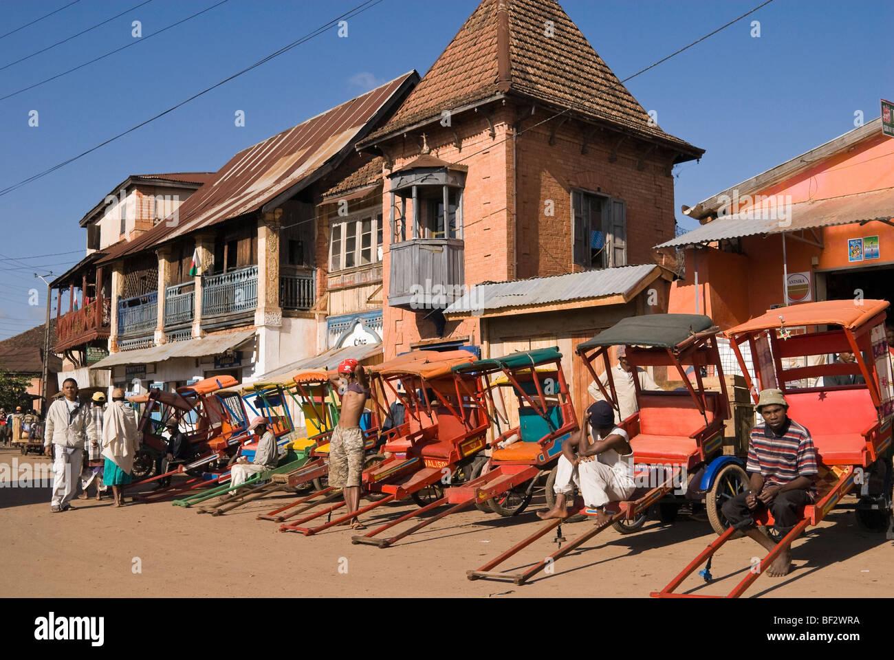 Rickshaw drivers waiting for customers, Ambositra, Madagascar - Stock Image