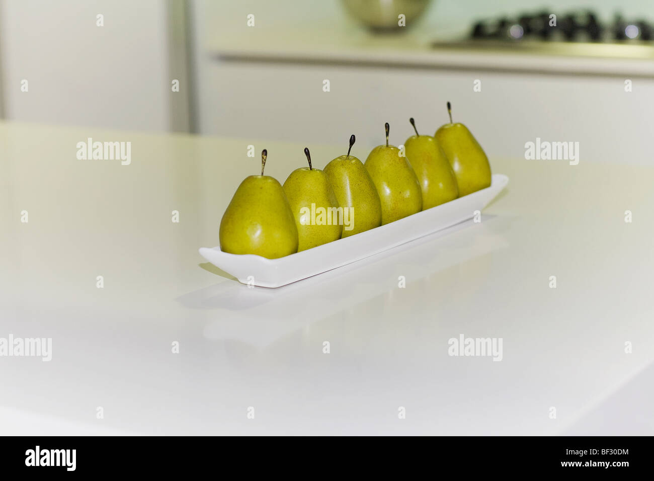 Artificial pears on a table Stock Photo
