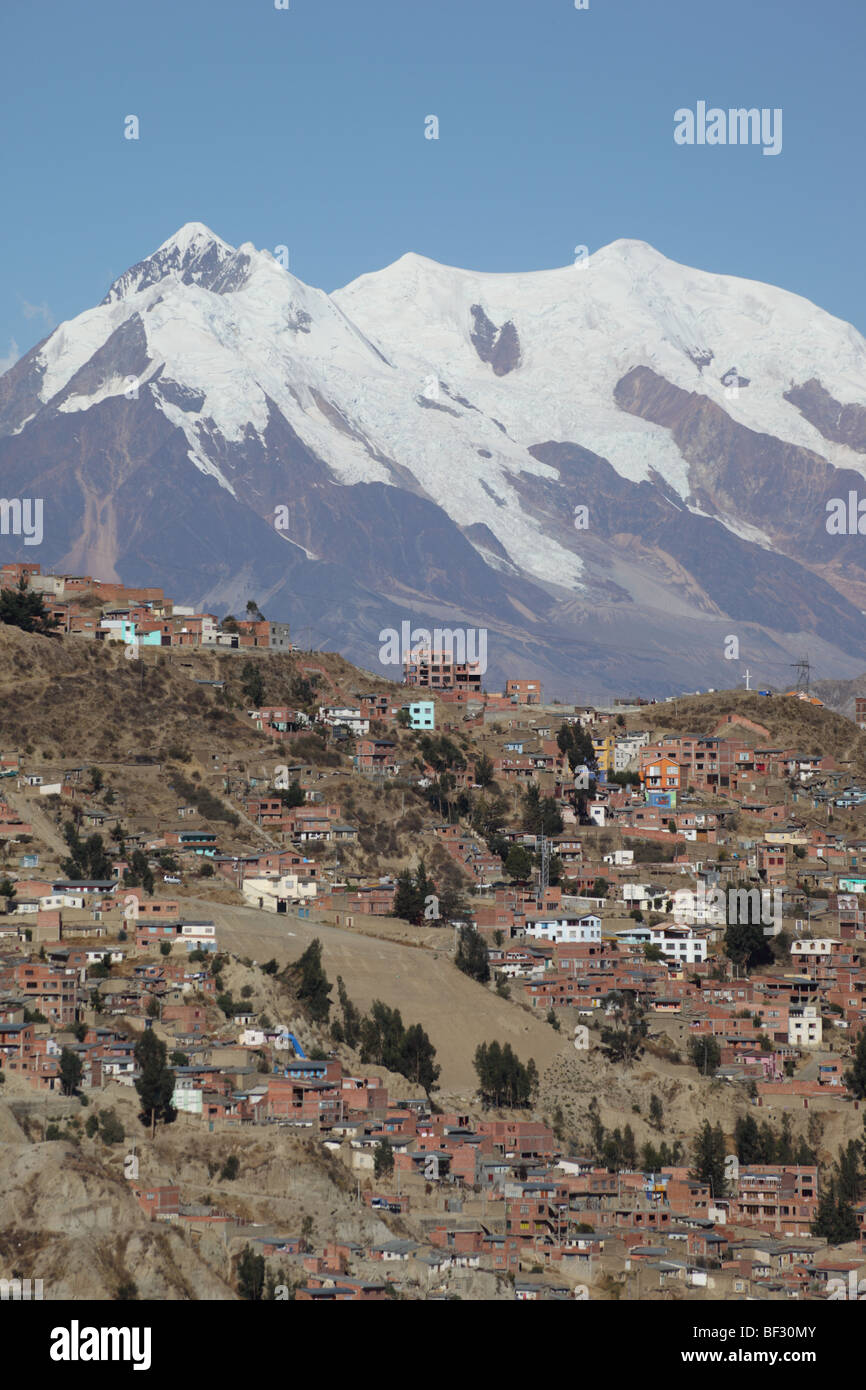 La Paz continues to expand outwards and up the surrounding hills, Mt Illimani in background , Bolivia - Stock Image