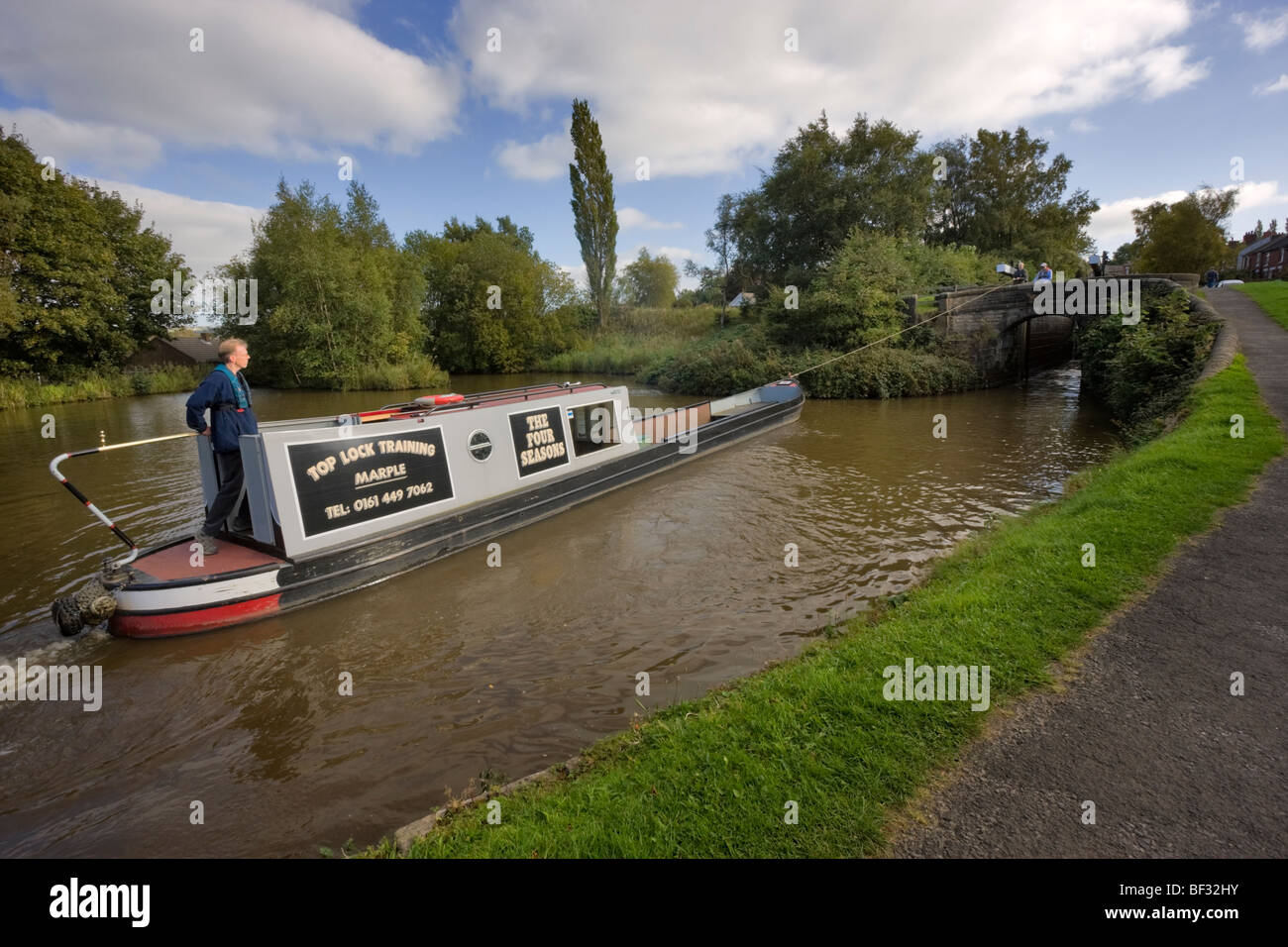 Student receiving instruction on a canal boat in the lock flight at Marple, Cheshire - Stock Image