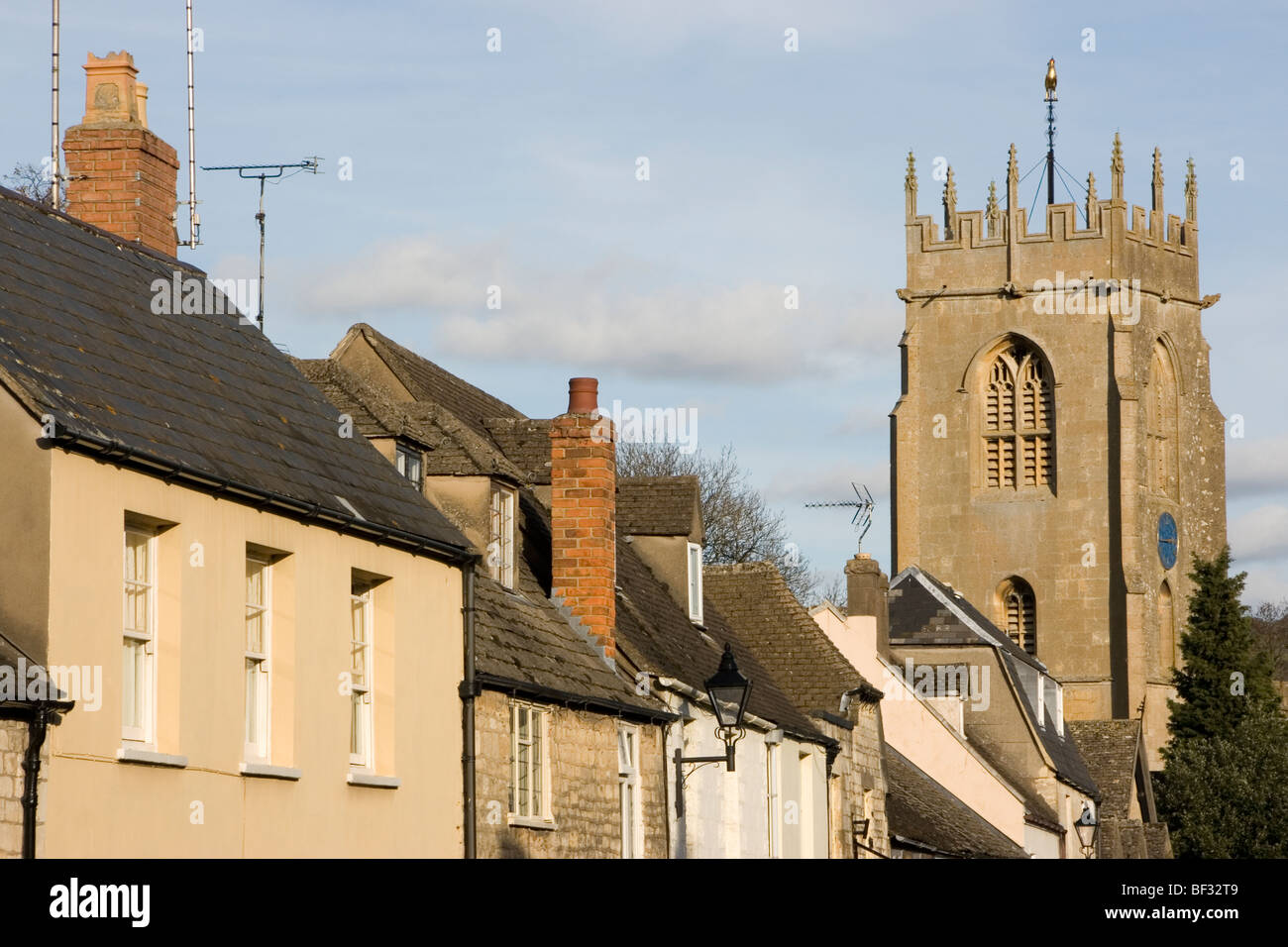 buildings and the tower of Saint Peters Church, Winchcombe, The Cotswolds, Gloucestershire, England Stock Photo