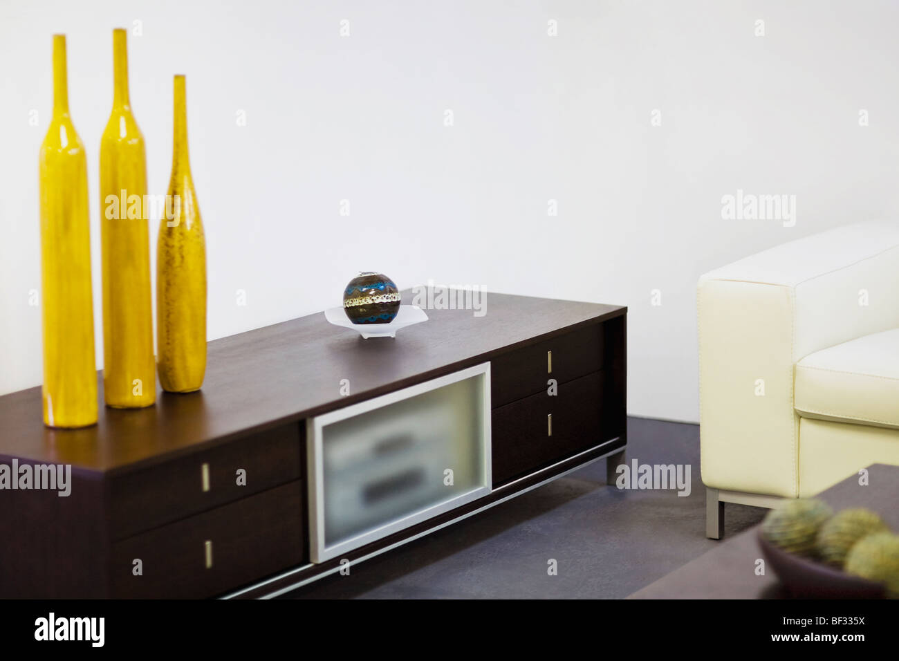 Showpieces on a drawer in a living room Stock Photo: 26498582 - Alamy