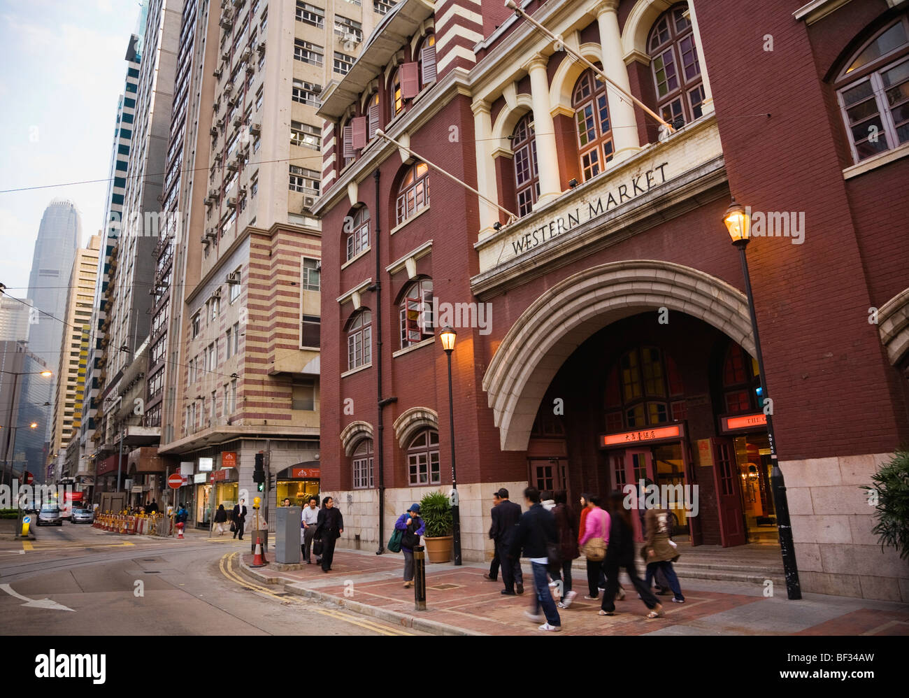 The Western Market is a historic landmark in Sheung Wan District with the IFC building beyond, Hong Kong, China - Stock Image