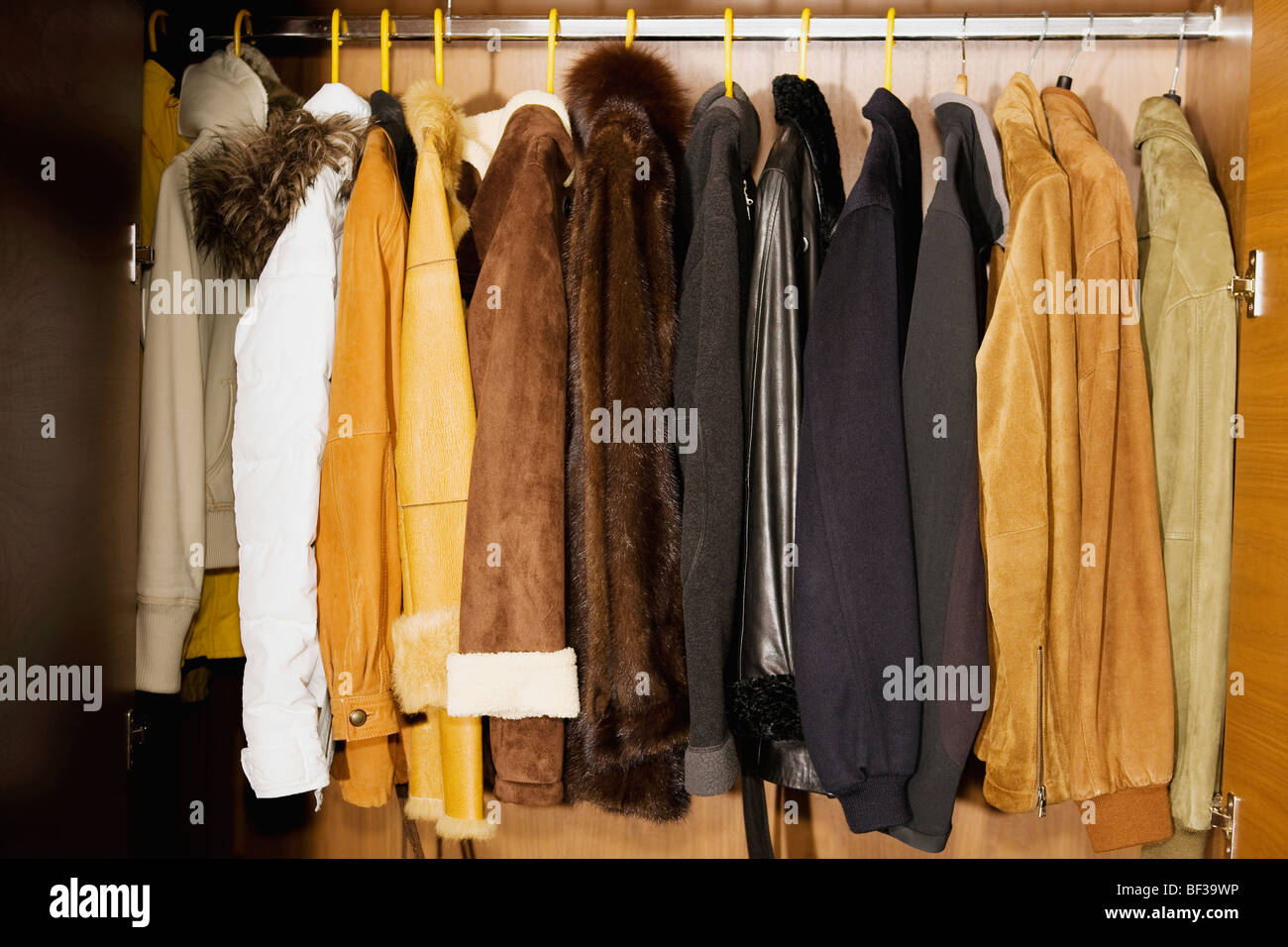 Clothes hanging in an almirah - Stock Image