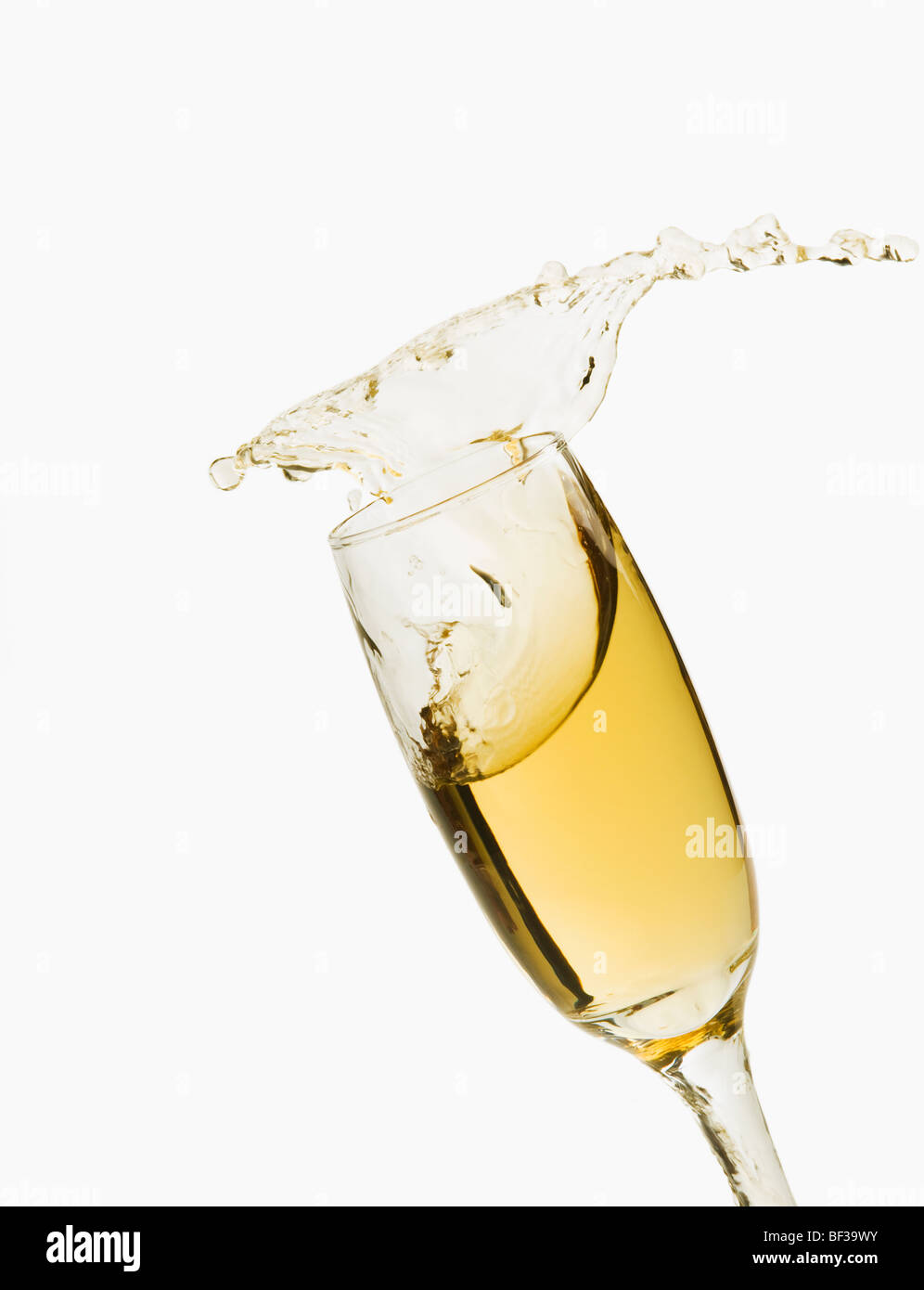 Close-up of champagne splashing in a champagne flute - Stock Image