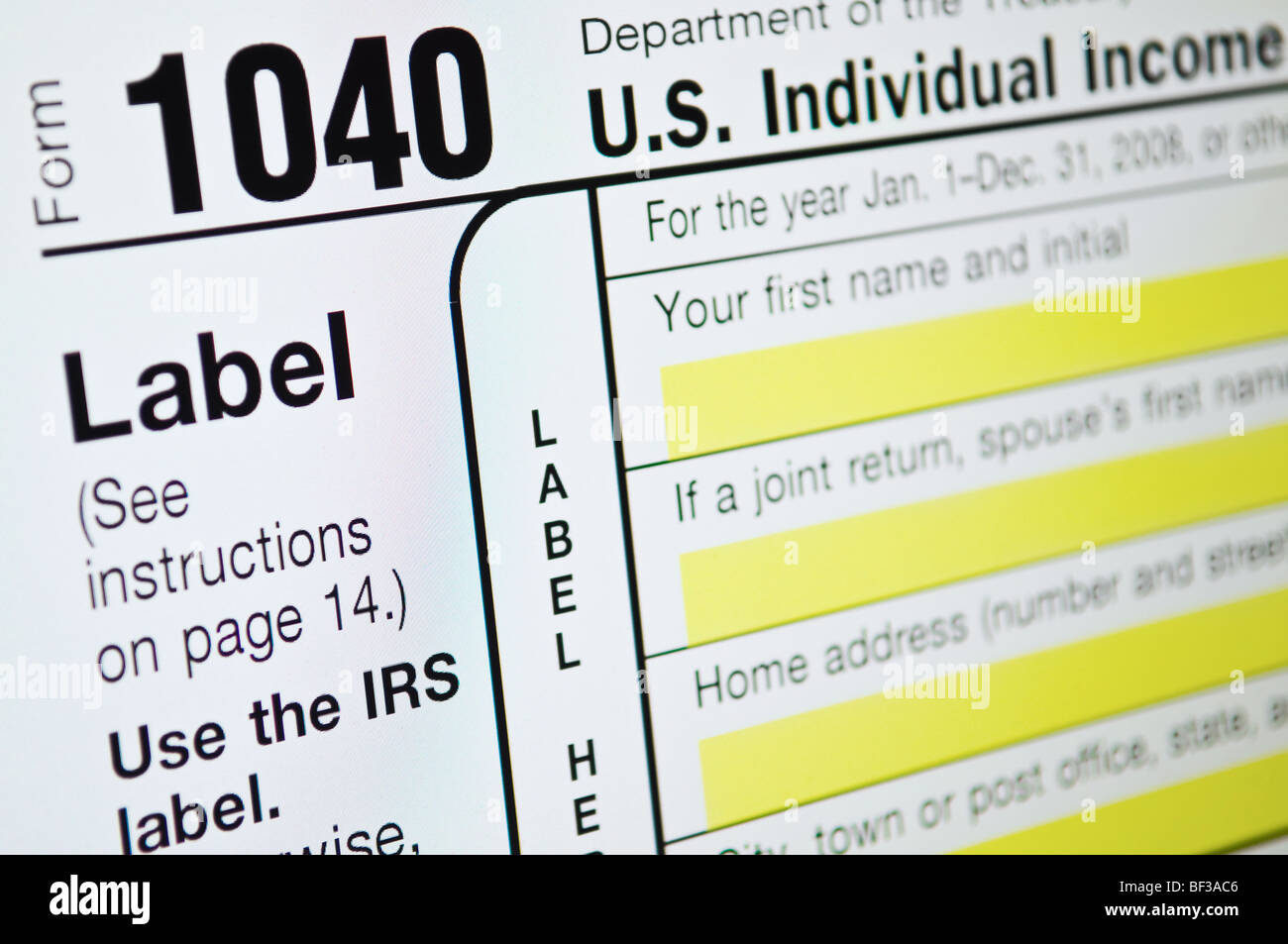 Individual income tax forms from the United States on computer monitor - Stock Image