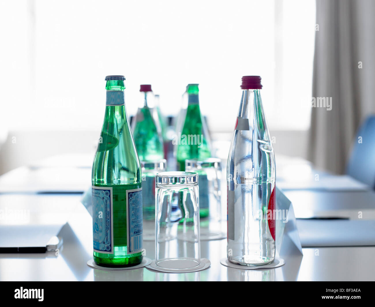 Bottles of water in a conference room - Stock Image