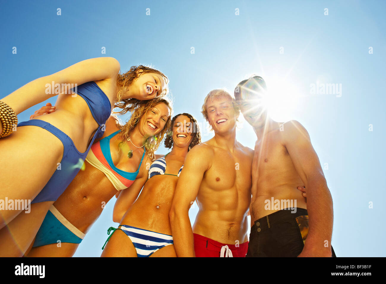 Group of young people in swim wear - Stock Image