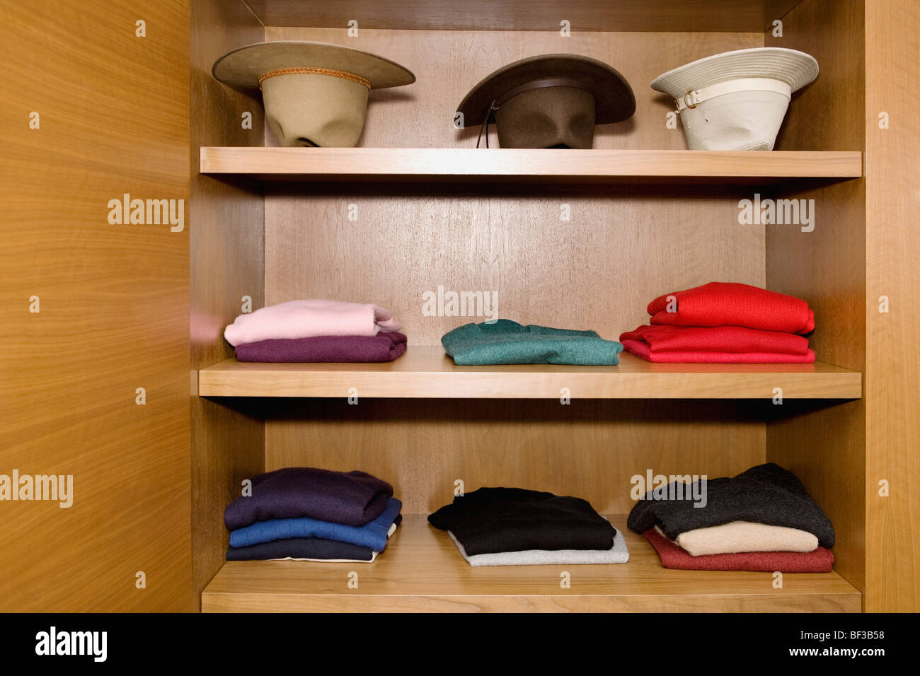 Clothes on shelves - Stock Image
