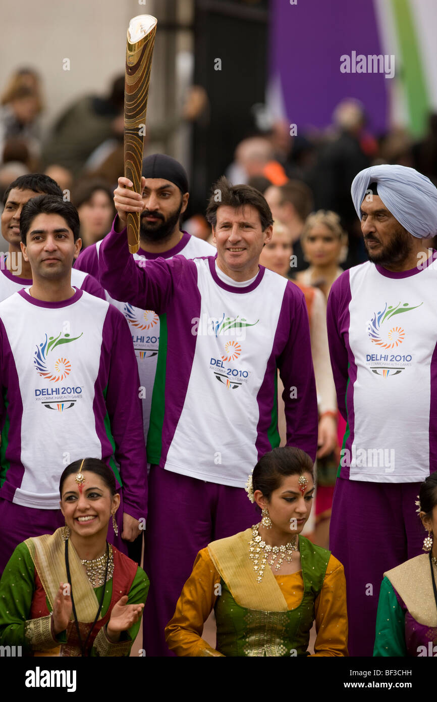 Lord Sebastian Coe holding the Queen's Relay Baton at the London start to the build up for the Delhi 2010 Commonwealth - Stock Image