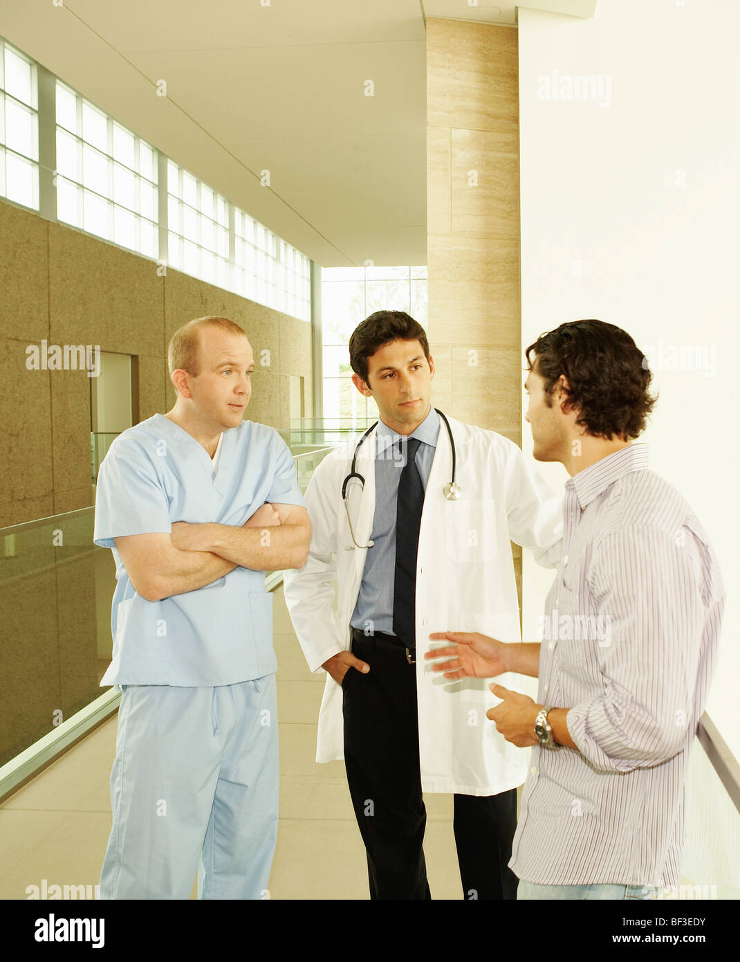 Doctor with patient in hospital Stock Photo