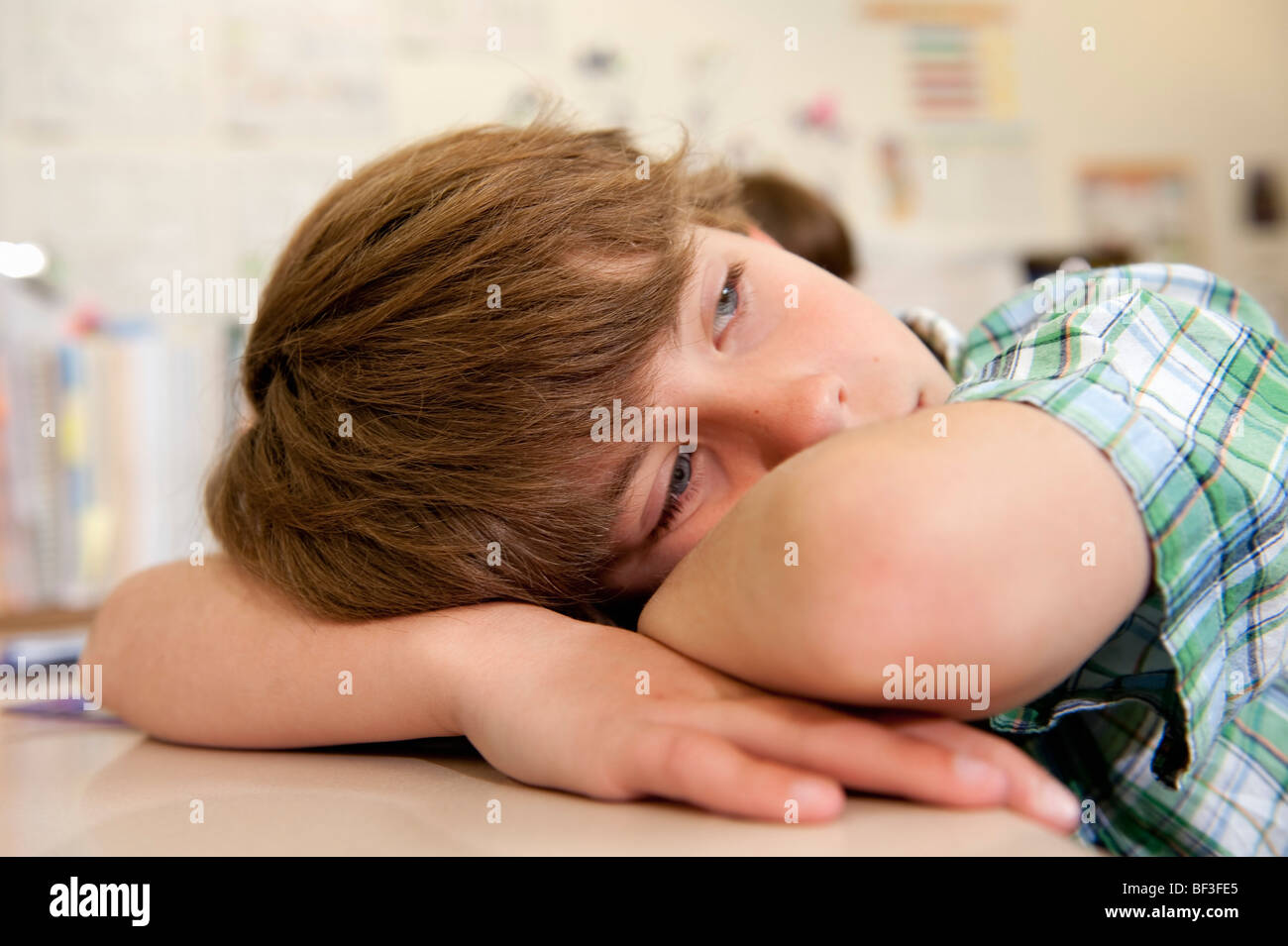 Student Resting during class - Stock Image