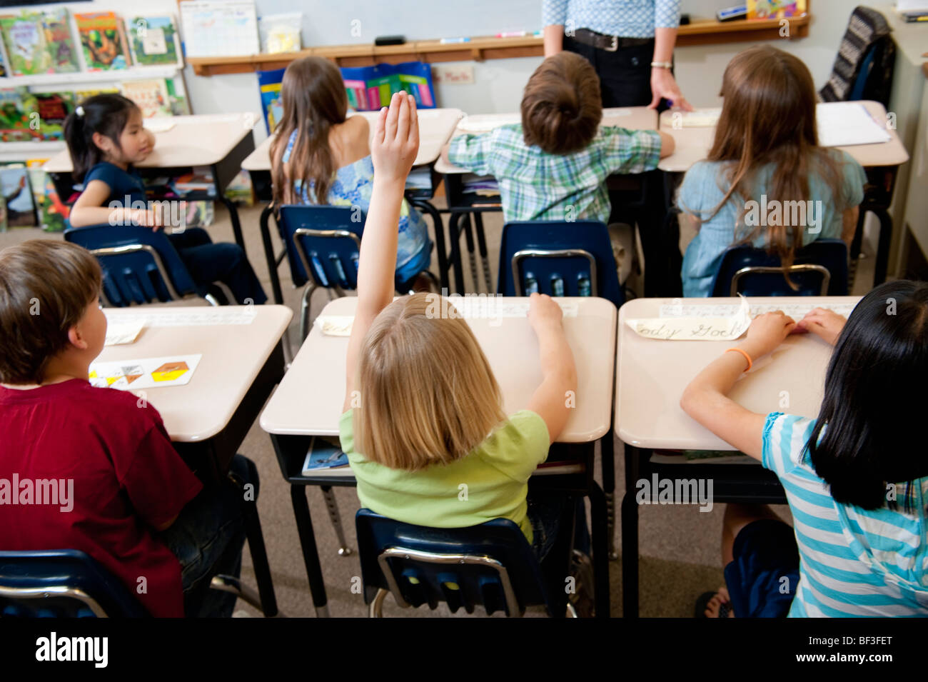 Elementary school class participation - Stock Image