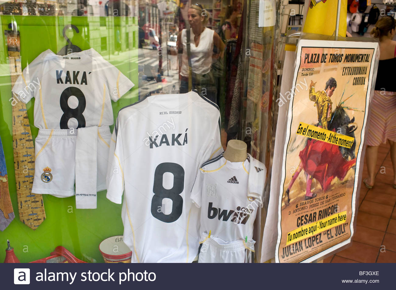 b03710422 Madrid shop window with Real Madrid football team shirts of the player Kaka  - Stock Image