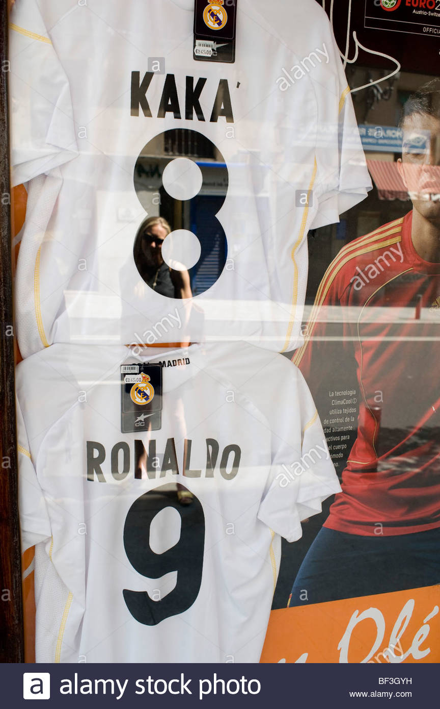 best website e7f03 9e1a0 Madrid shop window with Real Madrid football team shirts of ...
