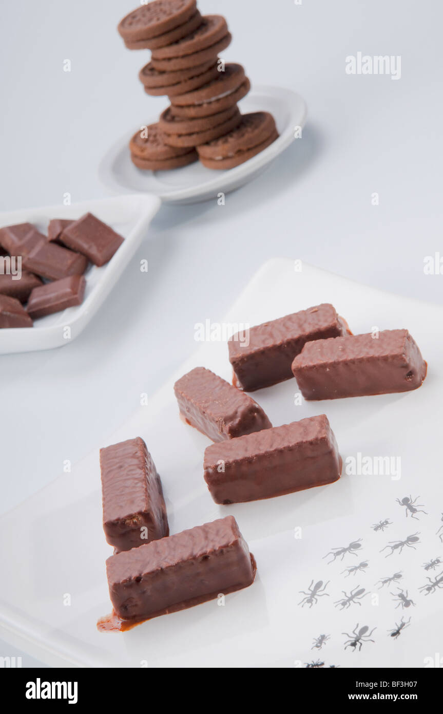 Close-up of chocolate pieces and  chocolate cookies - Stock Image