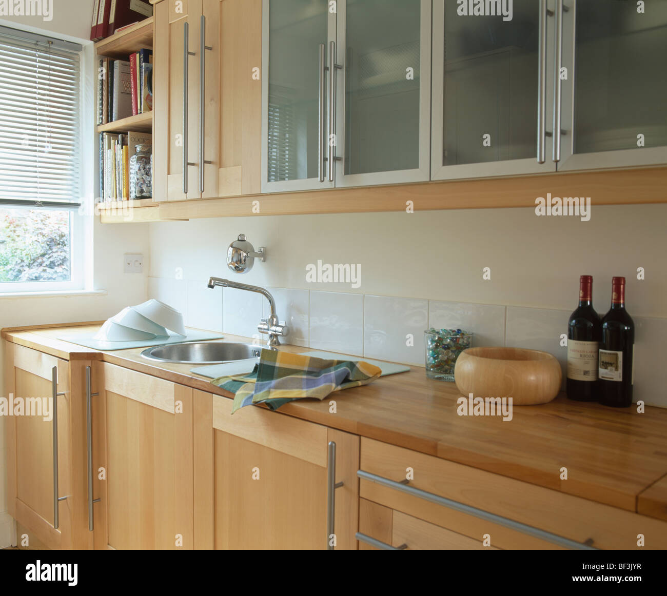 Glazed Kitchen Cabinet Doors: Fitted Cupboards With Glazed Doors Above Sink Set Into