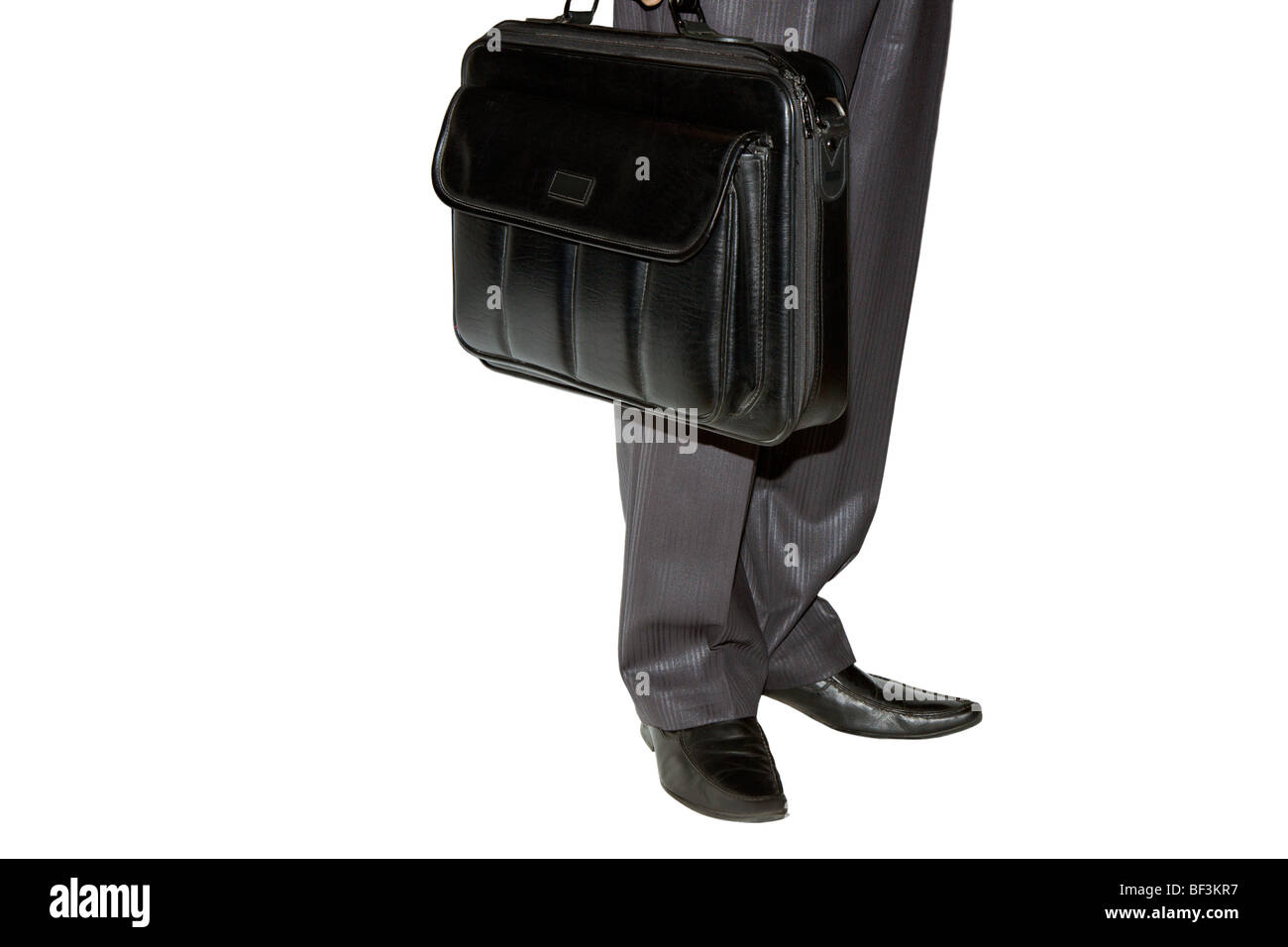 the man costs and holds in a hand an brief case Stock Photo