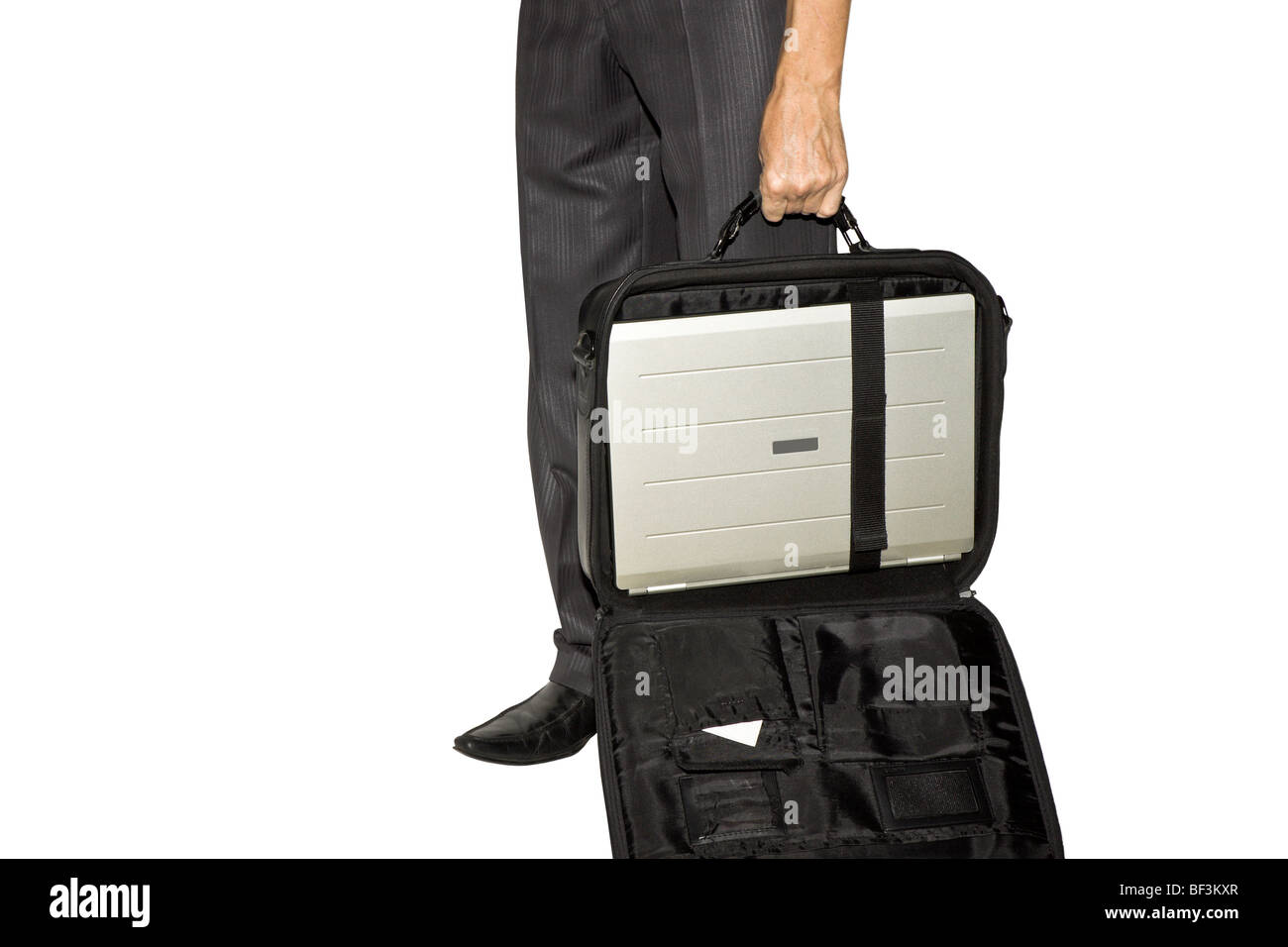 the man costs and holds in a hand an open bag with the laptop Stock Photo