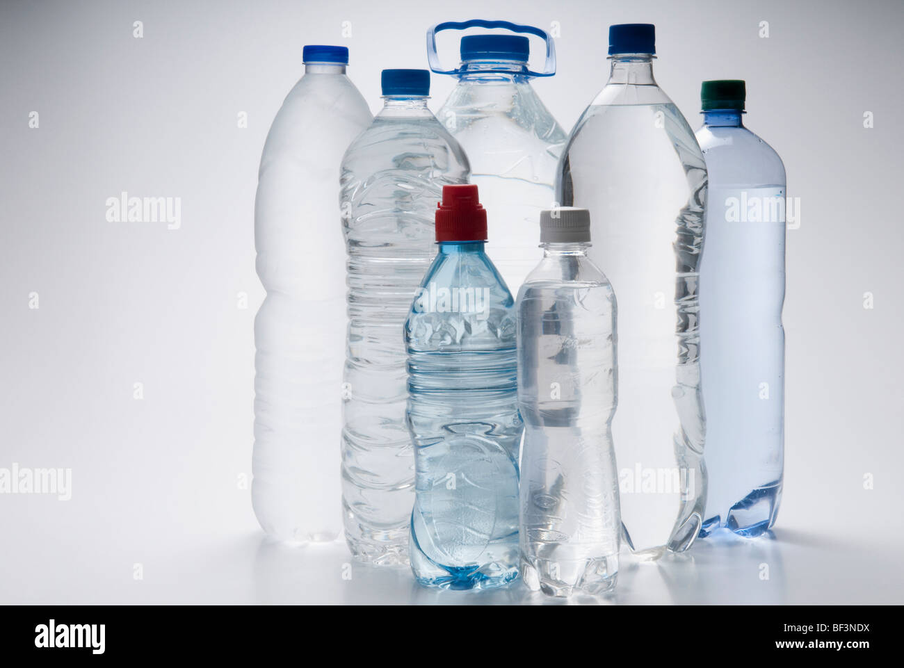 Assorted bottles of water - Stock Image