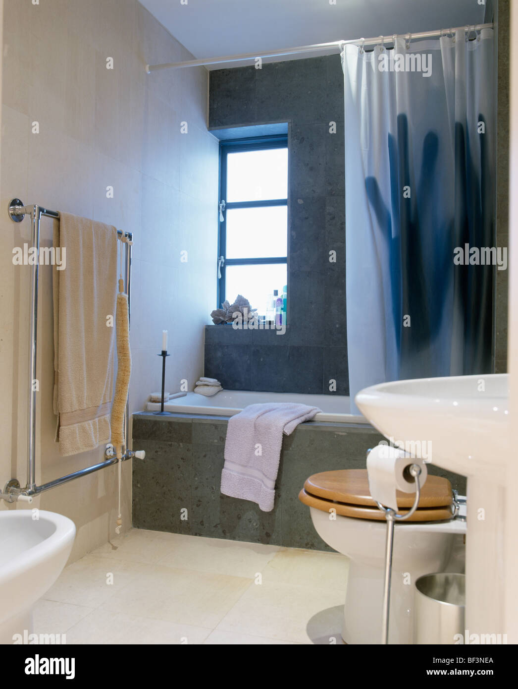 Granite Bath Surround In Modern Bathroom With Hands Printed On White Shower Curtain