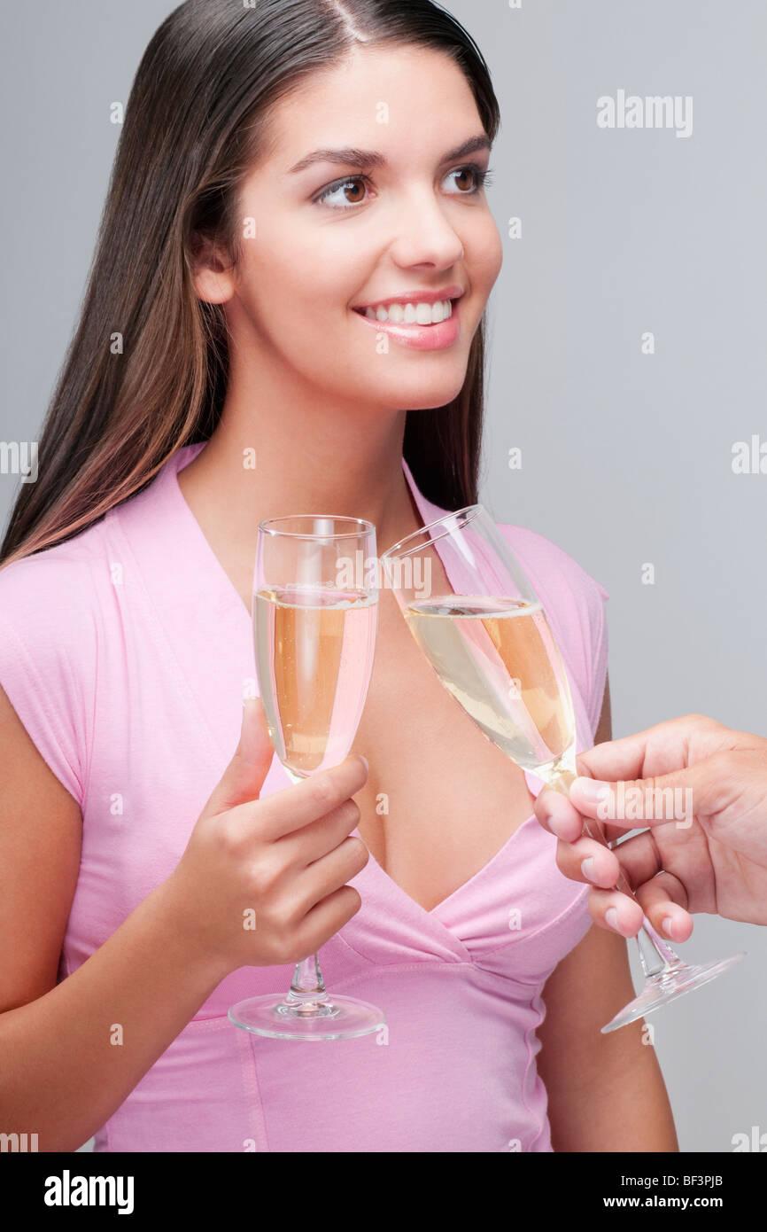 Couple toasting champagne flute - Stock Image