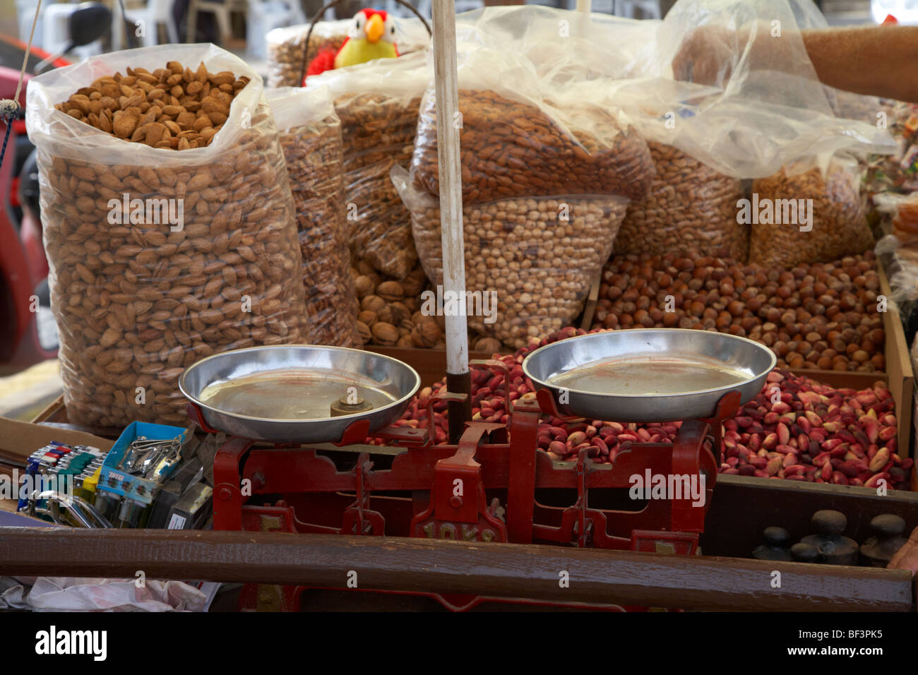 mixed nuts and scales on a nut sellers stall in famagusta turkish republic of northern cyprus trnc - Stock Image