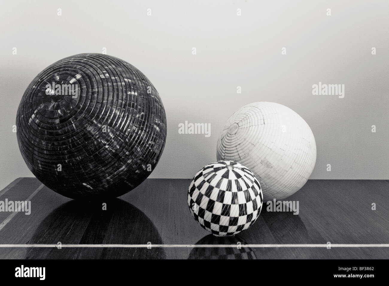 Three decorative balls on a chest - Stock Image