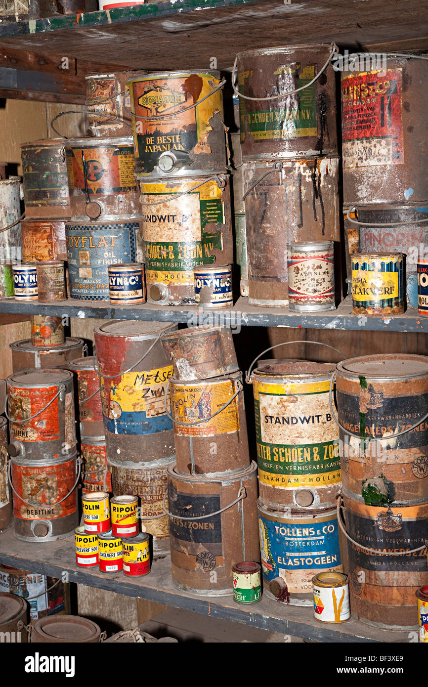 Tins of part used paint and varnish in workshop Zuiderzeemuseum Enkhuizen Netherlands Stock Photo