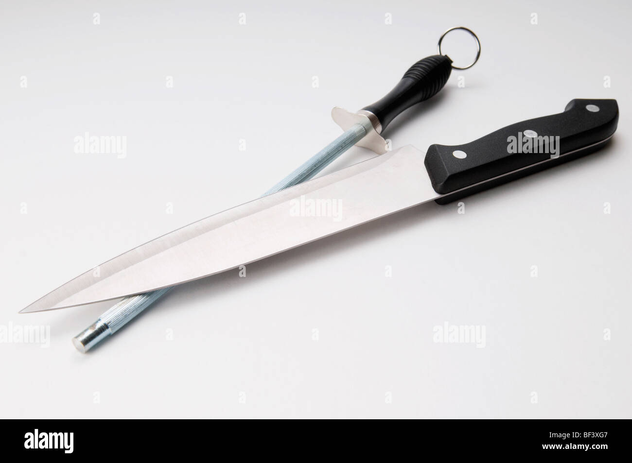 Close-up of a knife and a sharpening steel - Stock Image