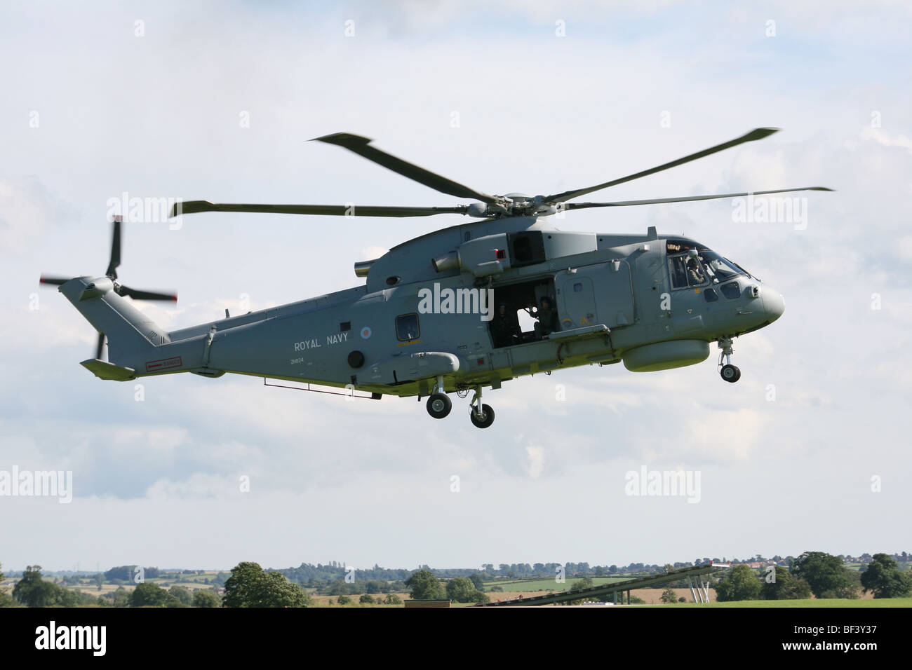 The UK Royal Navy Merlin medium lift helicopter is a variant of the EH101 helicopter developed by AgustaWestland. Stock Photo
