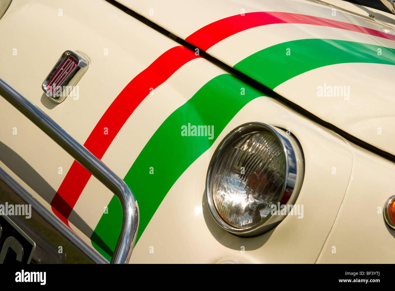 Headlight and badge of Fiat 500 with Italian stripes - Stock Image