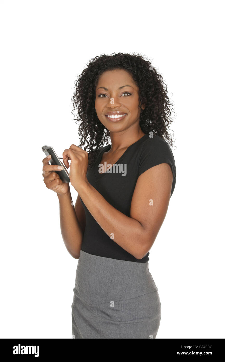 Beautiful African American woman holding a PDA on a white background - Stock Image